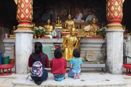 Worshippers at the Doi Suthep temple in Chiang Mai, Thailand
